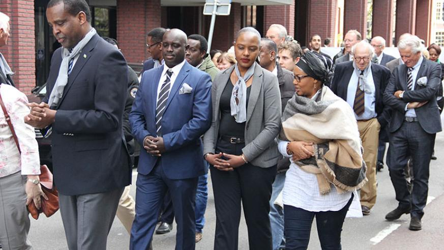 Amb. Karabaranga (L) leads mourners at the commemoration event in The Hague. / Courtesy