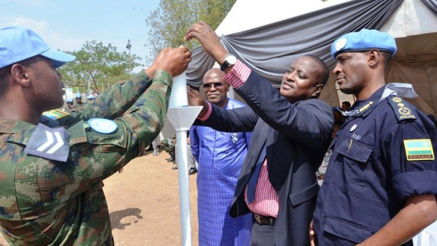 Members of the Rwandan police and military peacekeepers join officials in lighting Flame of Remembrance in the South Sudan capital of Juba, on Friday. The Rwandan police and milita....