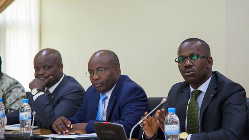 Uwizeyimana speaks at the news conference as Minister of State in charge of Transport, Dr Alexis Nzahabwanimana (C), and the Minister for Youth and ICT, Jean-Philbert Nsengimana, l....