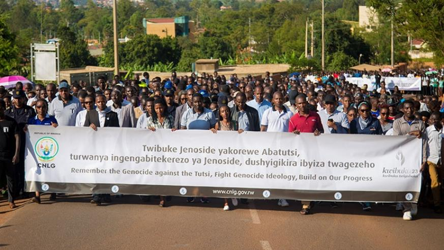Mourners in a walk to remember the victims of the Genocide against the Tutsi in Nyanza, Kicukiro yesterday.   (Faustin Niyigena)