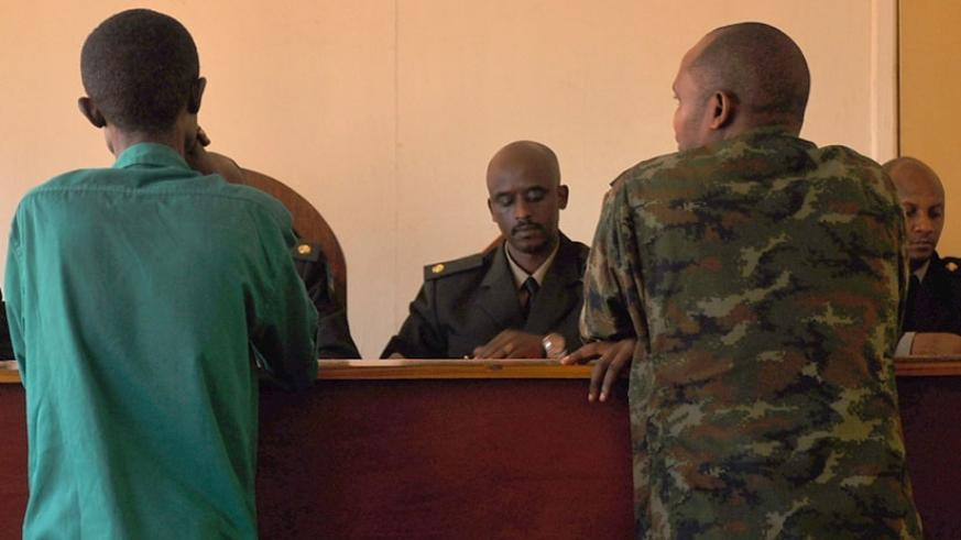 Nsanzimana and Major Rugomwa during a past court appearance. (File)
