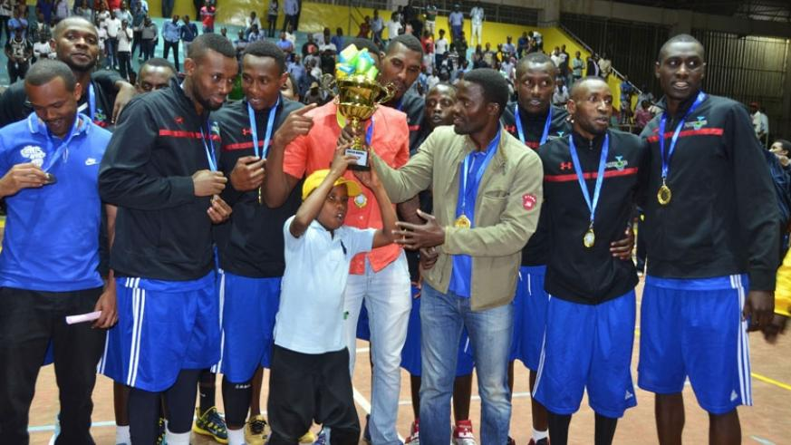 Patriots coach Mwinuka holds the trophy, along with his players after winning the 2016 Gisembe memorial regional title. (File)