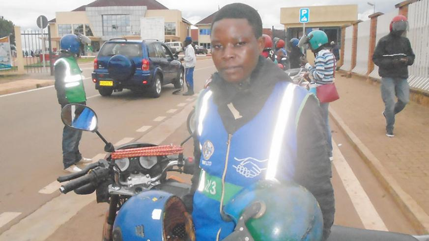 Nyirampeta, is the only female motorcyclist in the district.  (Photos by R. Niyingize)