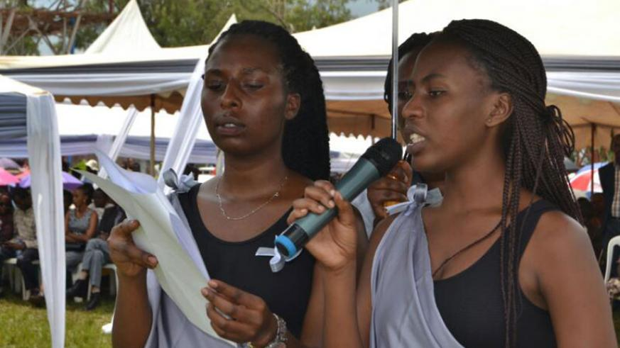 Young Genocide survivors read out the names of those who were killed in Kayonza. / Kelly Rwamapera