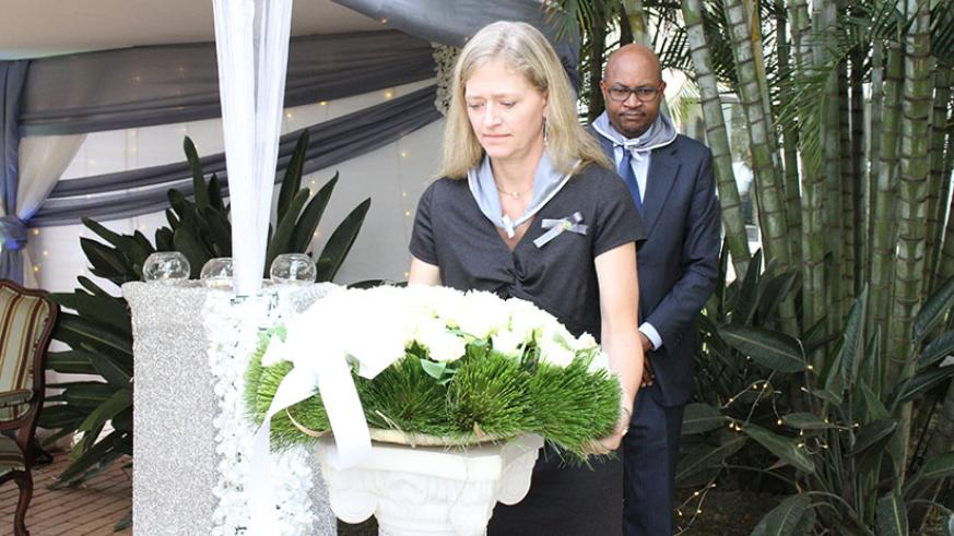 Amb. Barks-Ruggles lays a wreath at the U.S embassy's memorial plaque.  / Courtesy