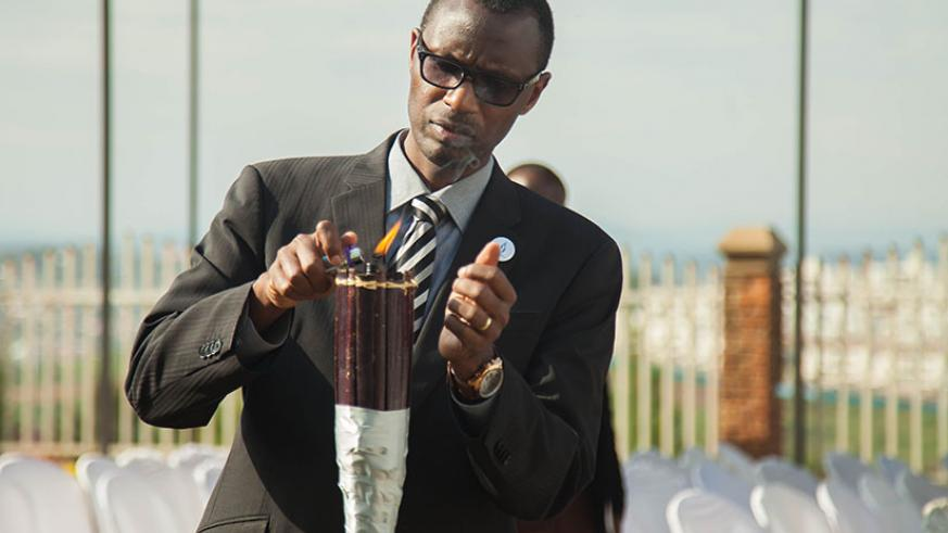 Minister Musafiri lights the Flame of Hope during the event. / Nadege Imbabazi