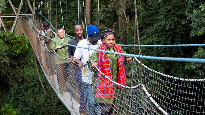 Local tourists on a160m walk on the Canopy in Nyungwe National Park during TemberuRwanda  campaign last year. Faustin Niyigena. Faustin Niyigena.