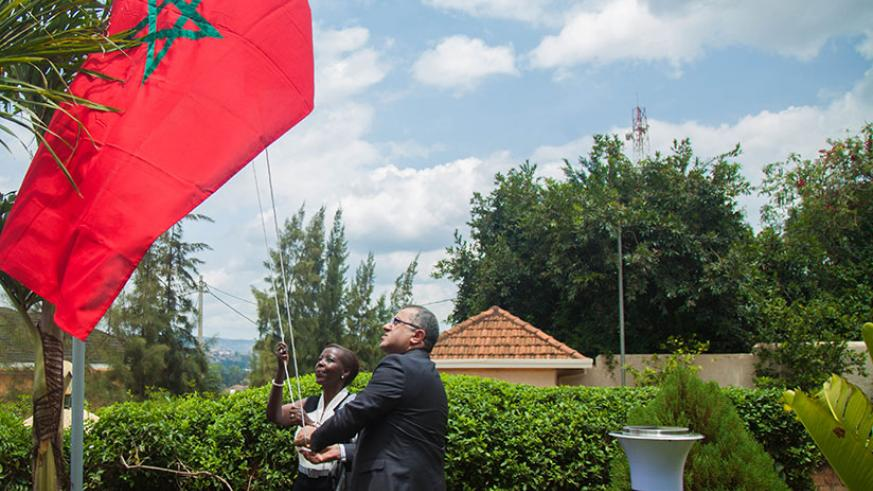 Minister for Foreign Affairs Louise Mushikiwabo and Youssef Imani, the Moroccan Ambassador to Rwanda raise the Moroccan flag at the new embassy in Nyarutarama, Kigali. Nadege Imbabazi.