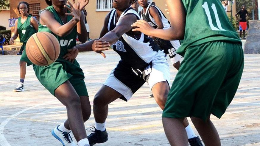 Peace Bamurange, left, seen here playing for NUR against APR in the national women basketball league. S. Ngendahimana