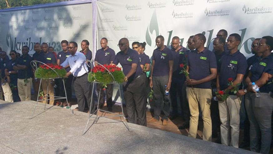 KCB Bank Rwanda staff lay wreaths at Genocide Memorial Centre in Gisozi. They had earlier participated in a 'Walk to Remember' from Kinamba to the centre. / Peterson Tumwebaze