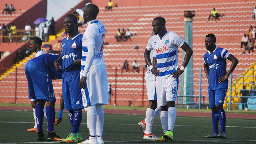 Rayon Sports' Malian striker Tidiane Kone (#15) looks on as right back Fiston Munezero (#2) calls on his team mates during their first playoff round match against Rivers United on ....