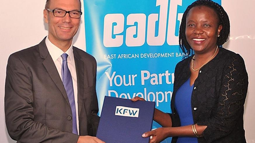 Oliver Junger, the KfW Kampala office director, and EADB's Yeda after signing the agreement. (Courtesy)