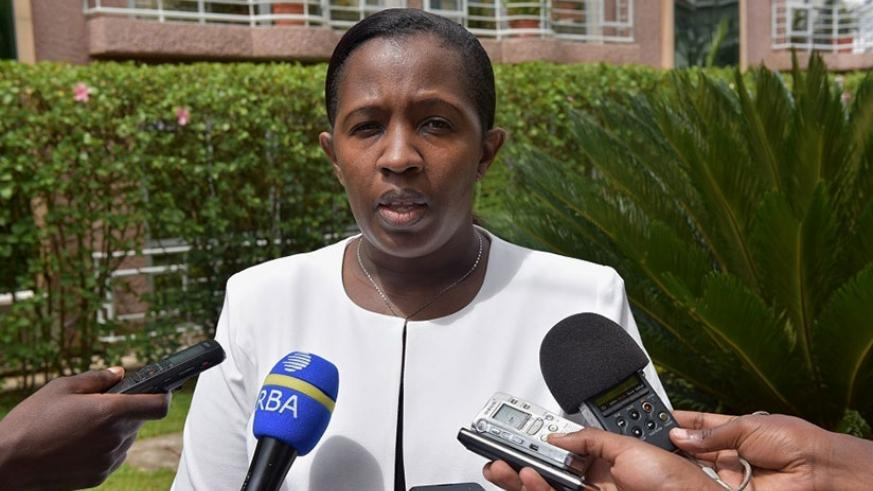 Uwamariya speaks to the media during the launch of the project to support graduation from poverty in Kigali, yesterday. (Courtesy photos)