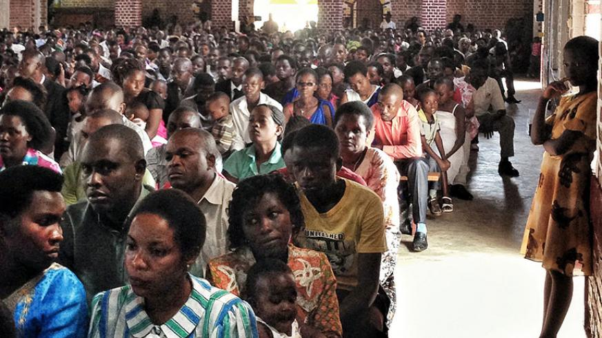 Christians during mass at Sainte Famille Catholic Church in Kigali.