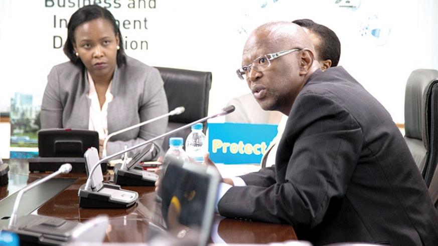 Thato Mokobi (R), the chief executive of the Copyright Society of Botswana, speaks during the press conference, as RDB chief executive, Clare Akamanzi looks on in Kigali, yesterday....