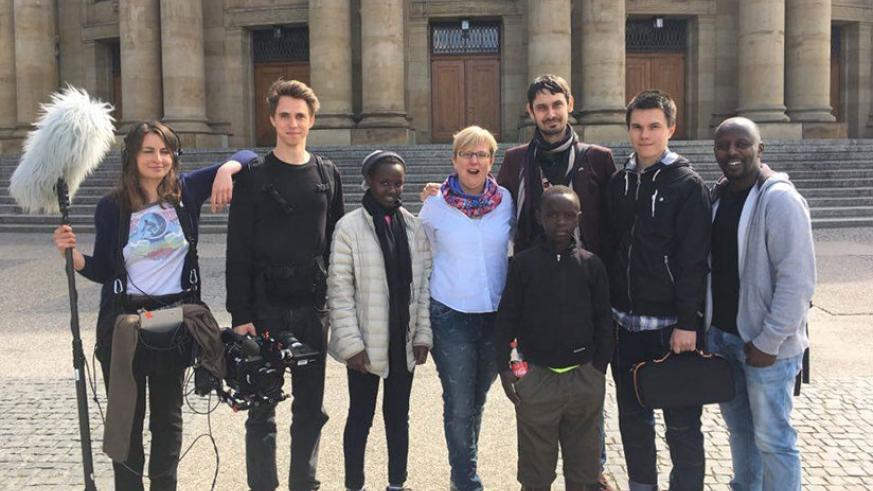 The Rwandan cast poses for photos with the German and Russian film crew.