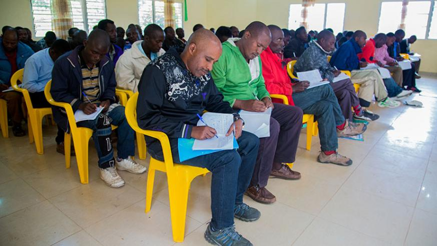 Former FDLR members take notes during a lesson at Mutobo camp in Musanze District. (Photos by Faustin Niyigena)
