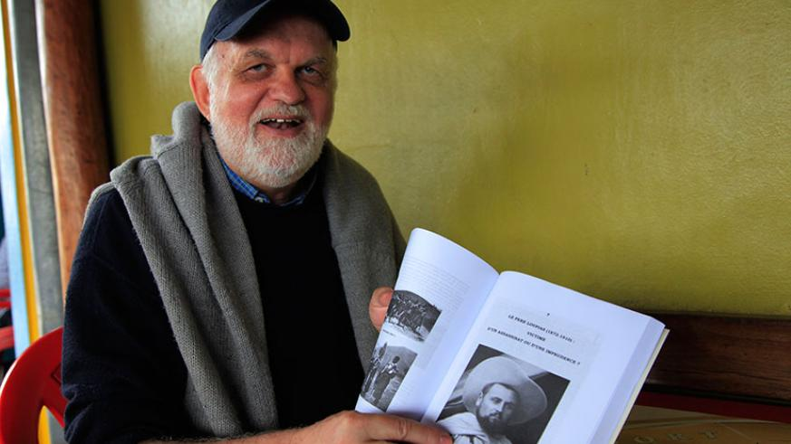 The Belgian author Father Minnaert shows some contents of his book on Rwandan history, launched last week in Kigali. (Sam Ngendahimana)