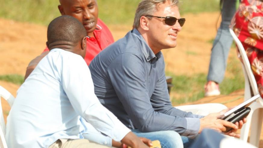 Amavubi head coach Hey (centre) has spent his time in Rwanda, since taking the job, watching league matches as he assesses the national players. / Courtesy
