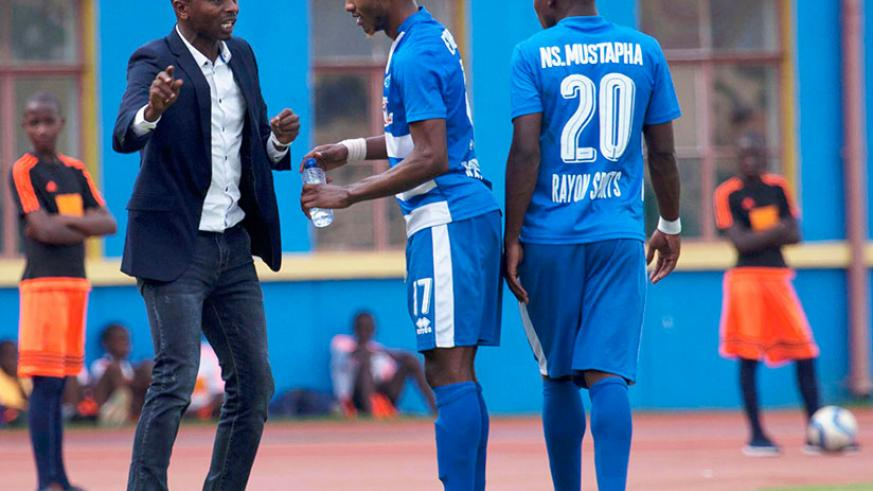 Djuma Masudi giving instructions to one of his midfield stars Fabrice Kakule Mugheni at the touchline.  The Burundian tactician has been given a one-week suspension by the club ove....