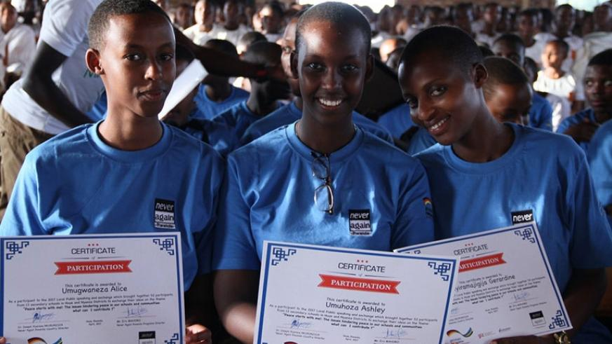 Participants with their certificates after the forum at Notre Dame de la Providence Karubanda in Huye District. (Photos by Remy Niyingize)