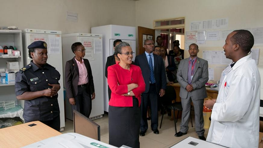 Mrs Tesfaye (C) is briefed about the operations of Isange One Stop Centre during her tour of the facility yesterday. Courtesy.