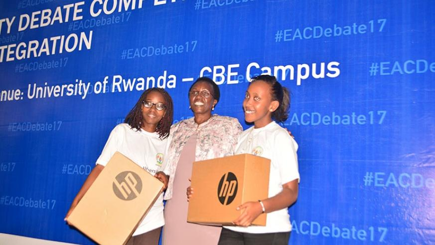 Hon Nyiramirimo, a member of EALA together with winners from Gitwe University