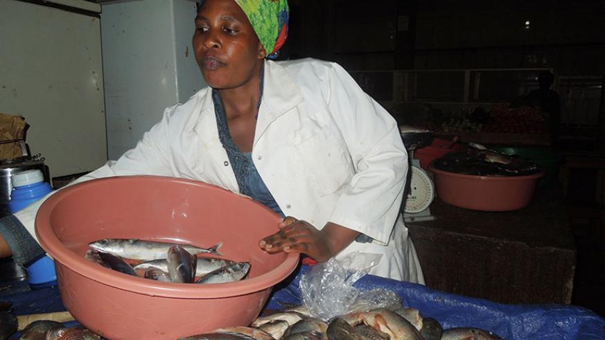 Uwimana sells fish in Ingenzi Market in Huye District. The trader has built a permanent house for her family. / Appolonia Uwanziga