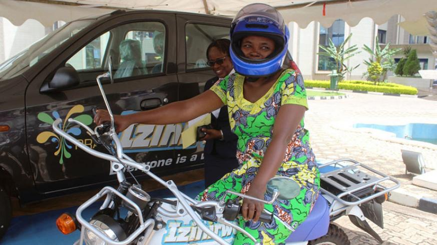 Kanyange poses with her motorcycle at RRA head offices. / Francis Byaruhanga