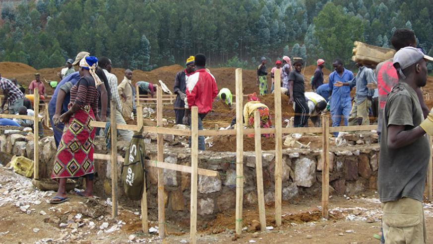 Residents of Karungu Village in Rutsiro District lay a foundation for their modern housing units late last month. / Eugene Kwibuka