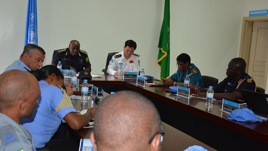 IGP Emmanuel K. Gasana and Shaowen Yang, the UN Deputy Police advisor at the opening of the Intermission retreat on Tuesday.