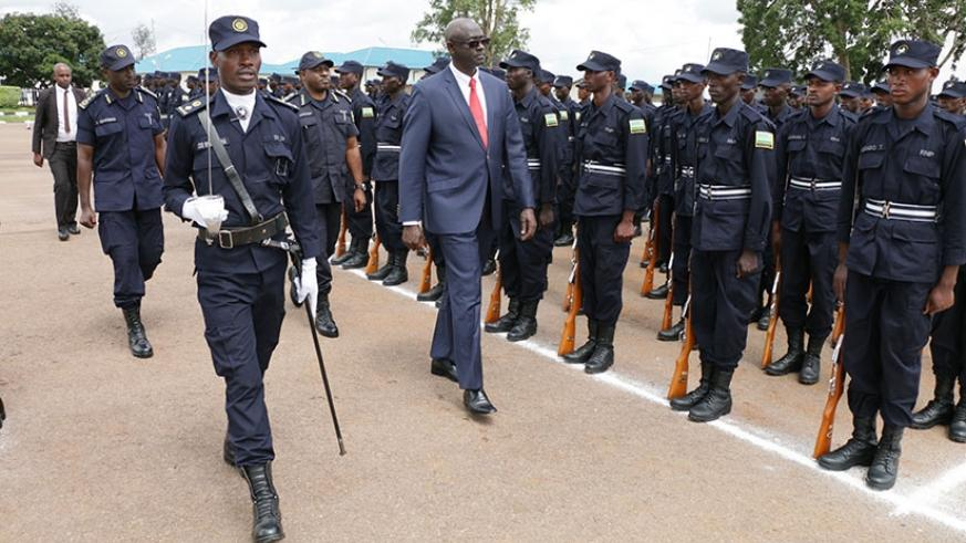 Minister Busingye inspects a guard of honour at the event yesterday. (Courtesy)