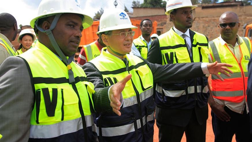 City mayor Nyamulinda (L) and Amb. Hongwei during the inspection of the construction works in Kigali. (Photos by Sam Ngendahimana)