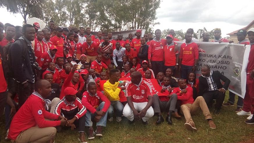 Liverpool fans pose for a group photo after laying a wreath at Mukarange mass grave. (Geoffrey Asiimwe)