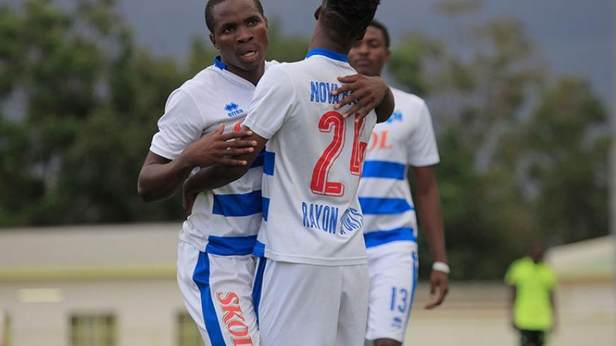 Rayon Sports' winger Mustapha Nsengiyumva celebrates his goal with Nova Bayama who assisted him to score a brace (Photos by Sam Ngendahimana)