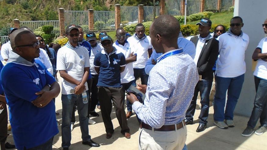 A guide at Bisesero Genocide memorial briefing BDF staff. (Photos by Steven Muvunyi)