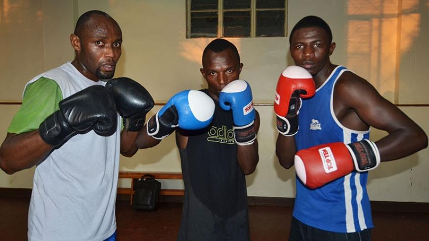 Boxers Vincent Nsengiyumva (L), David Nsabimana (C) and Jean Pierre Cyiza are part of the team that will represent Rwanda in Brazzaville. (S. Ngendahimana)