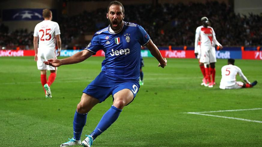 Higuain wheels away in celebration after giving the Italian giants the lead at the Stade Louis II on Wednesday evening. Net photo