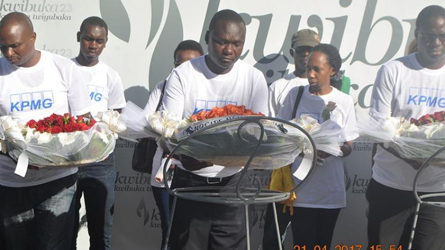 Ineget (C) and some staffers lay wreaths on graves at Kigali Genocide Memorial. Courtesy.