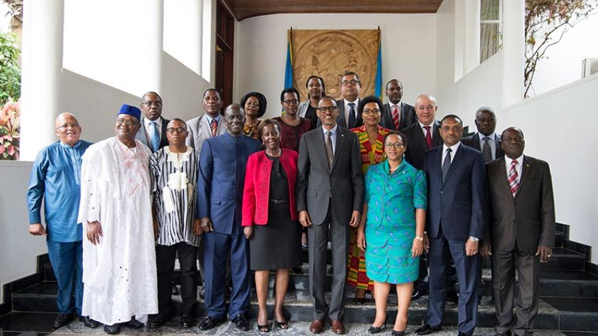 President Kagame poses for a group photo with the visiting members of the African Union Peace and Security Council in Kigali on Friday. The council members have been attending a retreat in Rwanda this week. Village Urugwiro.