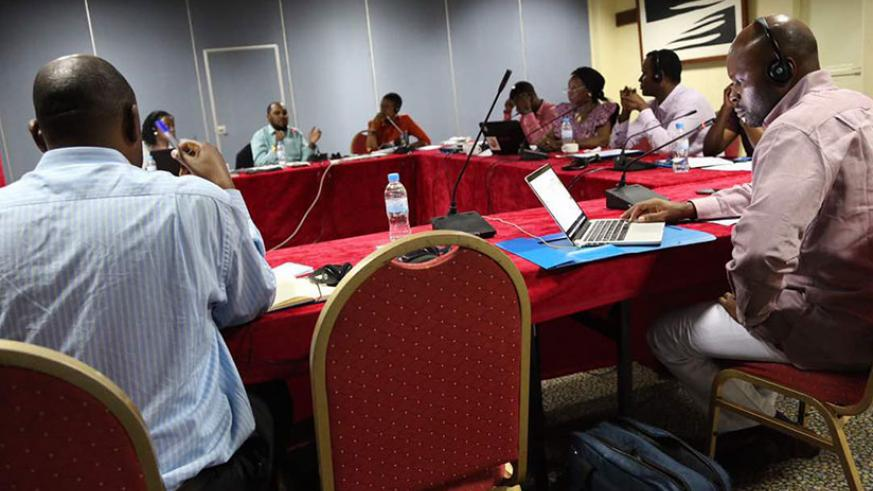 ADF management committee members deliberating at the meeting.