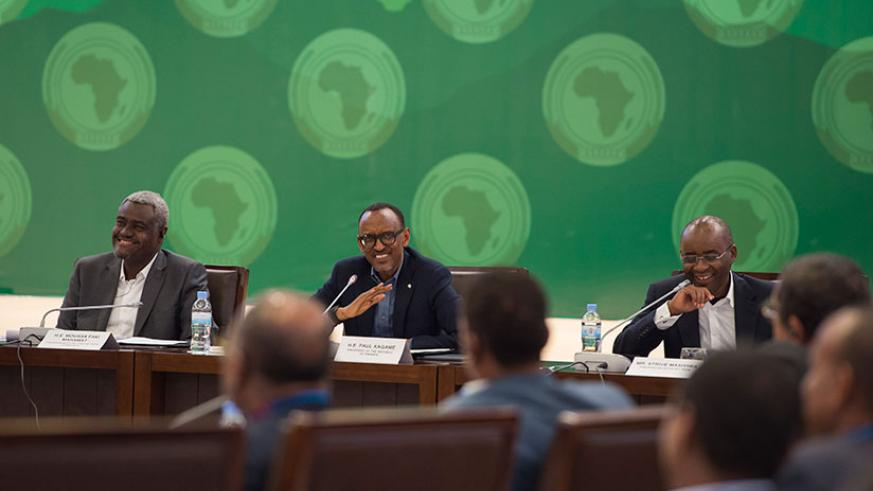 President Kagame with African Union Commission chairperson Moussa Faki Mahamat (L), and Strive Masiyiwa, a member of the Pan-African Advisory team and founder of Econet (R), at a consultative meeting on the African Union Reforms in Kigali, yesterday. / Village Urugwiro