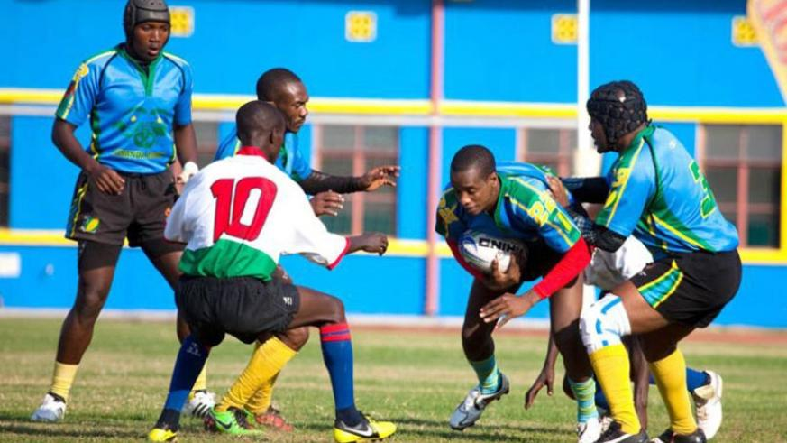 National rugby team captain Jean de Dieu Hakizimana (with the ball) in action against Burundi in CAR Cup four years ago. (File)