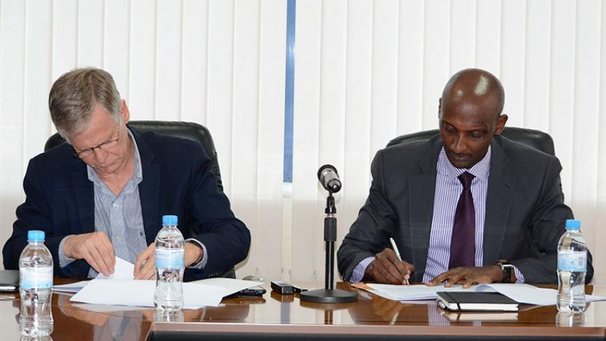 Prof. Krogh (L) and Tusabe sign the Memorandum of Understanding in Kigali, yesterday. (Courtesy)