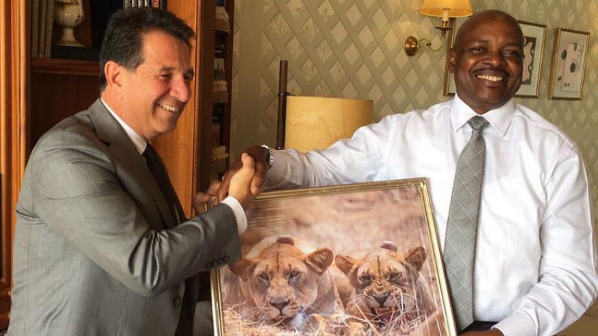 Amb. Nkurunziza (R) hands over a gift to Tarek Ragheb. (Courtesy)