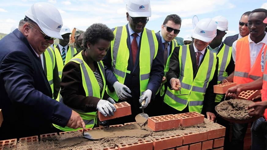 Musoni (centre), the State Minister for Energy and Water, Germaine Kamayirese (2nd left), and other officials lay the foundation for an 80MW peat power plant in Gisagara on Tuesday. File