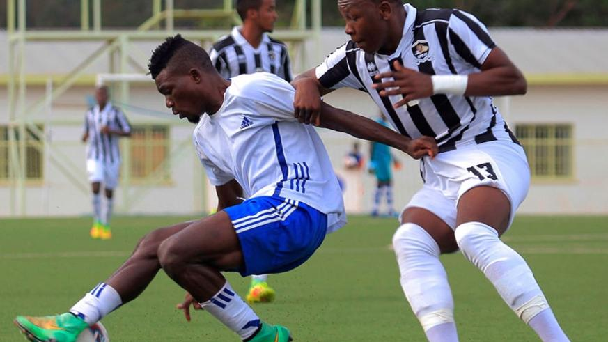 Pepiniere FC's Michel Nduwimana controls the ball against APR  defender Aimable Nsabimana during a recent league match at  Kigali Stadium. (Sam Ngendahimana)