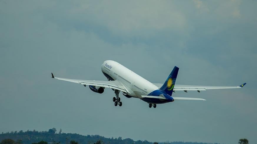 A RwandAir plane takes to the skies. Restrictions have affected the growth of the aviation sector in the region.