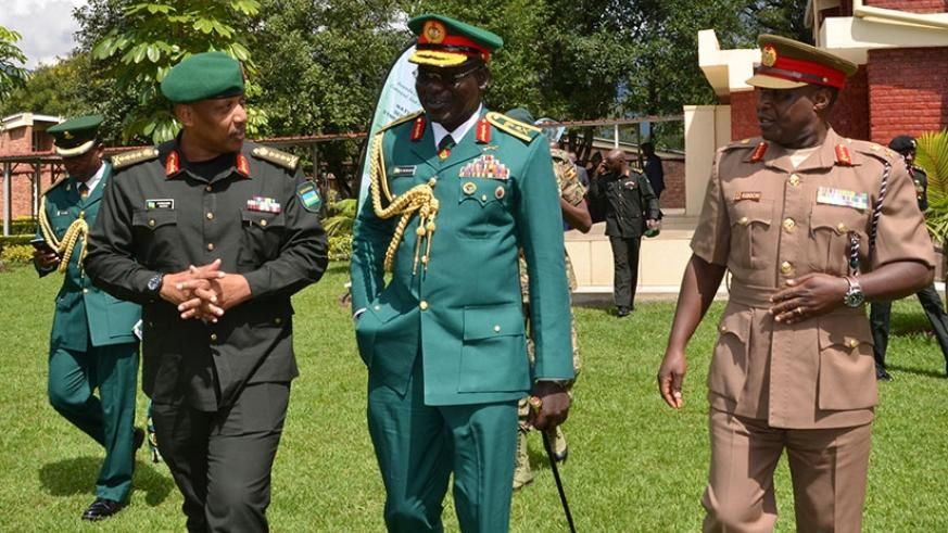 Chief of Defence Staff Gen Patrick Nyamvumba (L) chats with officers from other African states after the opening of the symposium yesterday. (Michel Nkurunziza)