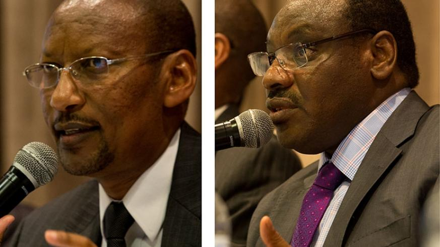 Finance and Economic Planning minister Claver Gatete (R) and central bank governor John Rwangombwa speak during a seminar in Kigali to discuss Rwanda's and the region's outlook yesterday.(Photos by Timothy Kisambira)